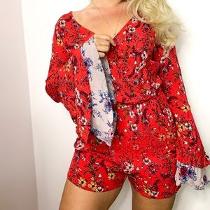 Xhiliration floral bell sleeve 70's style romper